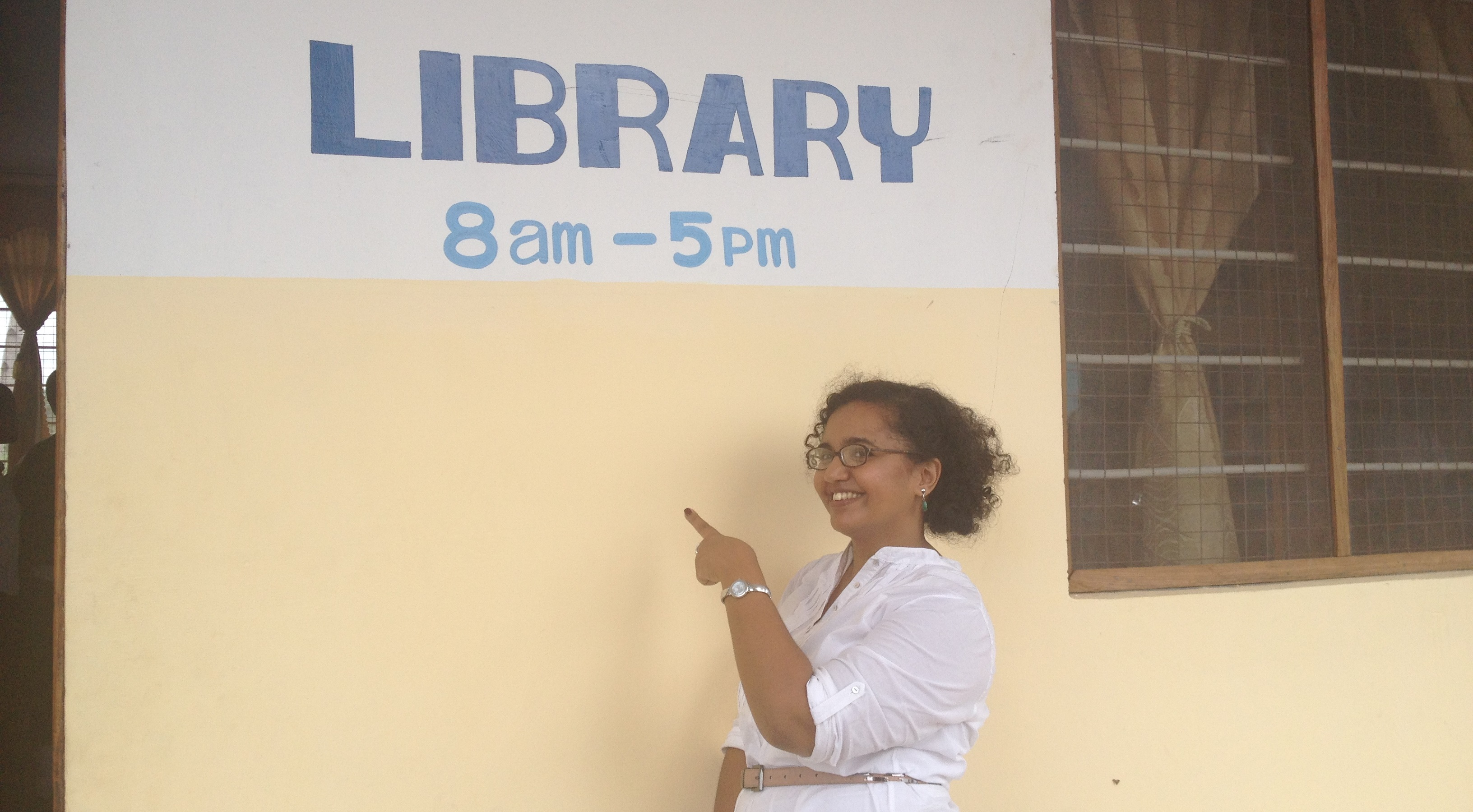 Montse outside the new library at Kinyerezi Secondary School