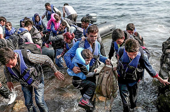 Syrian refugees debarking at Lesbos, Greece. Photo courtesy Freedom House.