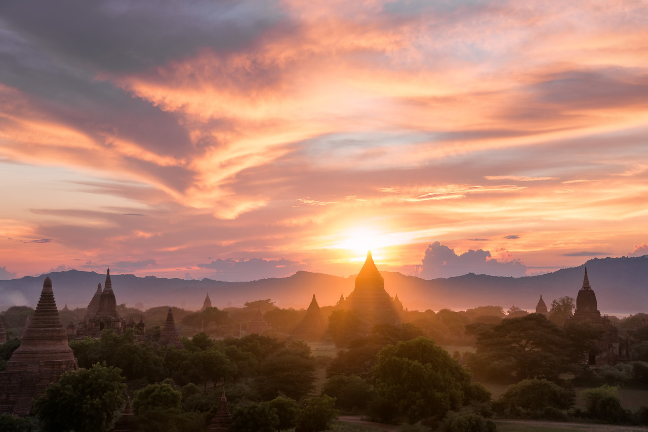 """Sunset behind Mingalazedi Pagoda, one of the many temples in Bagan, Myanmar."""