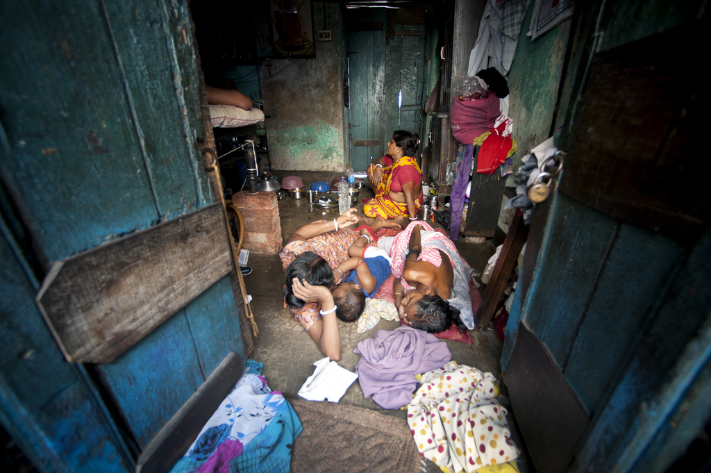 A family living in an urban slum in Sonagachi.
