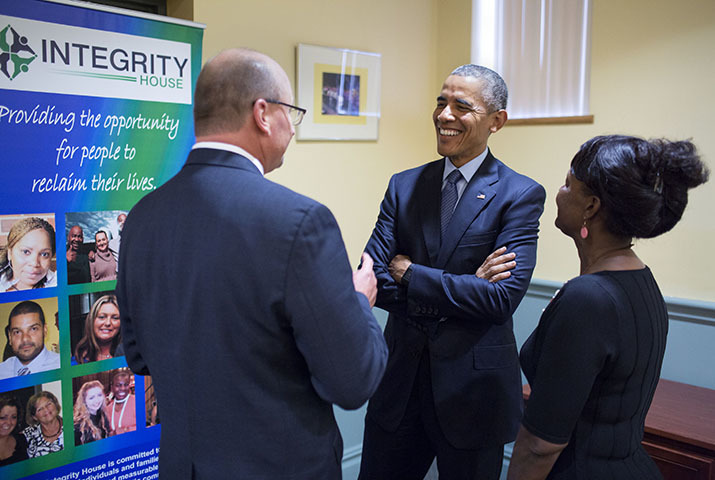 President Barack Obama arrives at Integrity House in Newark, New Jersey, Nov. 2, 2015. Greeters are Robert Budsock, CEO and President of Integrity House and Robin Shorter, Director of WISE Program for Women, Women's Supportive House and Federal Probation Program. The President visits the rehabilitation facility to discuss criminal justice reform and programs that help former prisoners re-enter the community.  (Official White House Photo by Pete Souza)  This photograph is provided by THE WHITE HOUSE as a courtesy and may be printed by the subject(s) in the photograph for personal use only. The photograph may not be manipulated in any way and may not otherwise be reproduced, disseminated or broadcast, without the written permission of the White House Photo Office. This photograph may not be used in any commercial or political materials, advertisements, emails, products, promotions that in any way suggests approval or endorsement of the President, the First Family, or the White House.