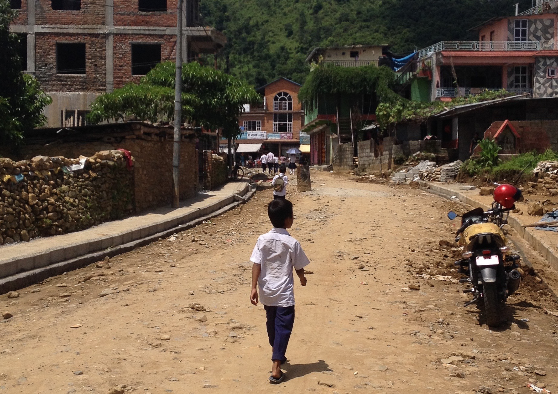 NEPAL-GLOBAL-SCHOOLING-BOY-ROAD-DIRT