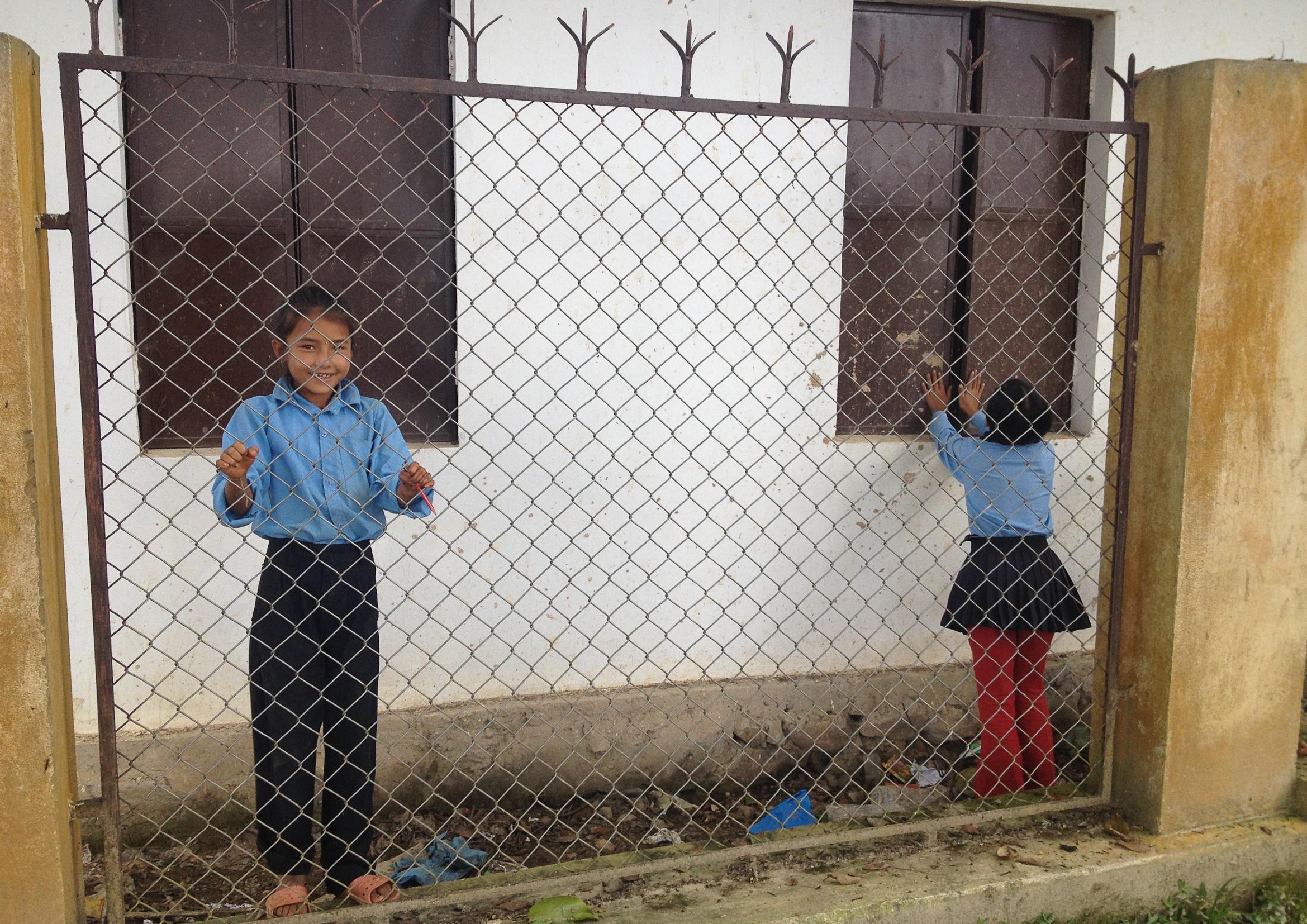 nepal school education fence boy girl