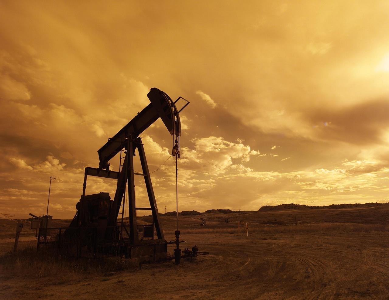 oil-pump-jack-sunset-clouds-silhouette-impakter-trump-madman-threory-imperialism