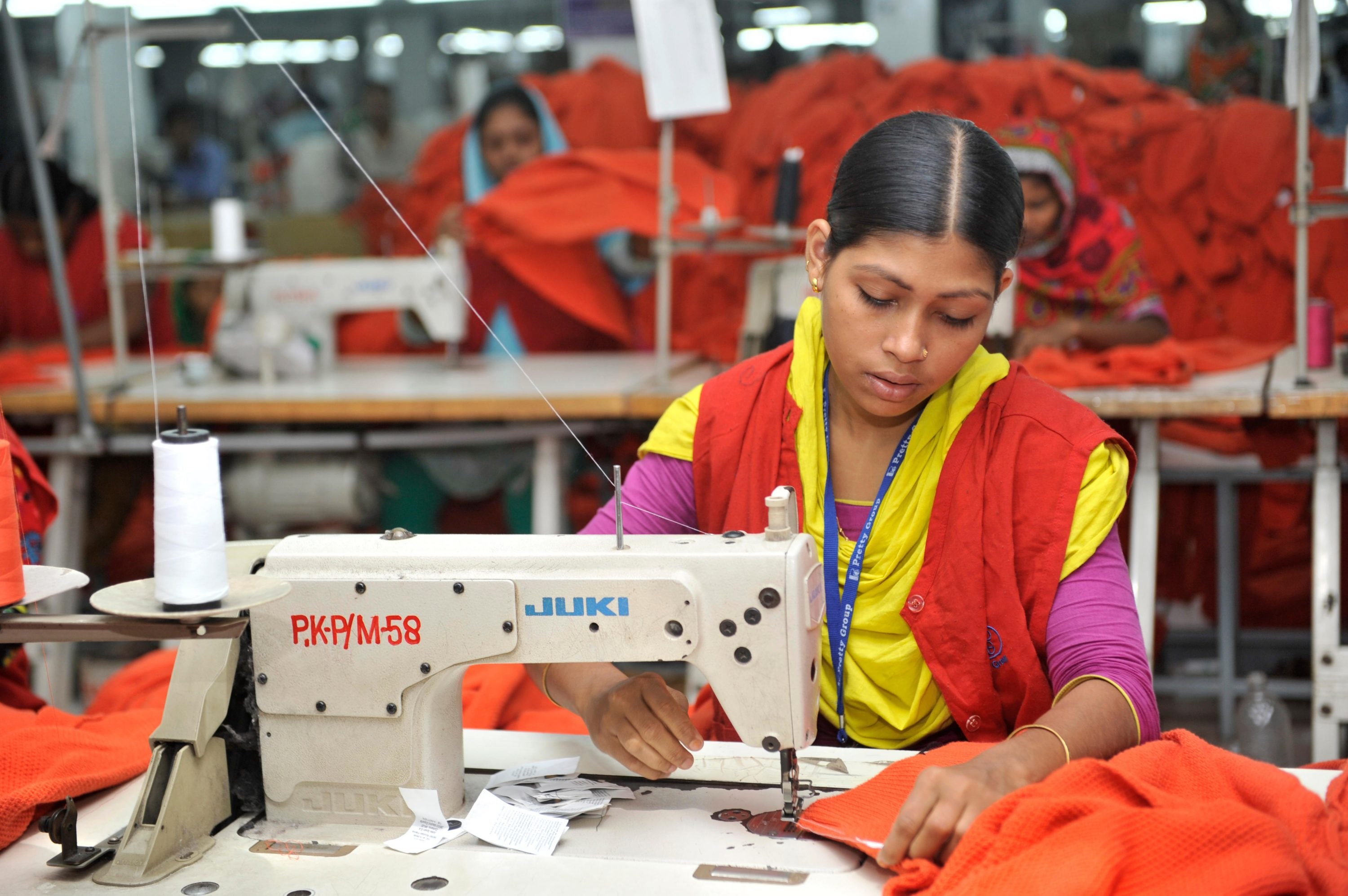 Gajipur, Bangladesh - November 2, 2013: Bangladesh clothing and garment factories are often filled with hundreds of female laborers who work long shifts for, often, low wages. When Bangladeshi women are separated from their husbands or are being divorced,