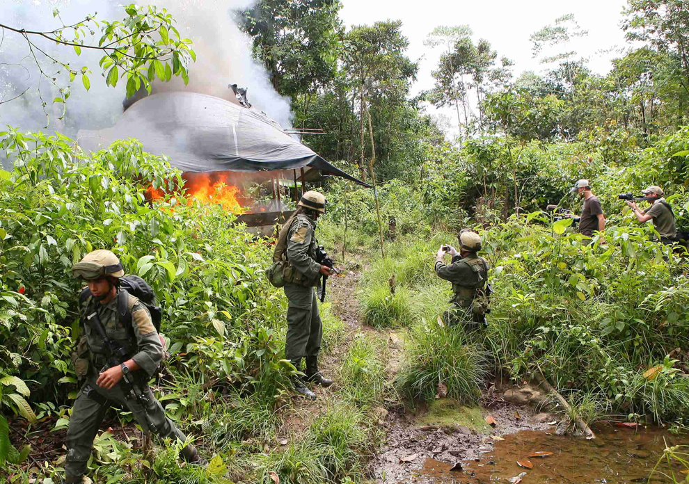 Anti-narcotic police officers destroy a cocaine laboratory in Llorente Colombia July 2009 (AP Photo)