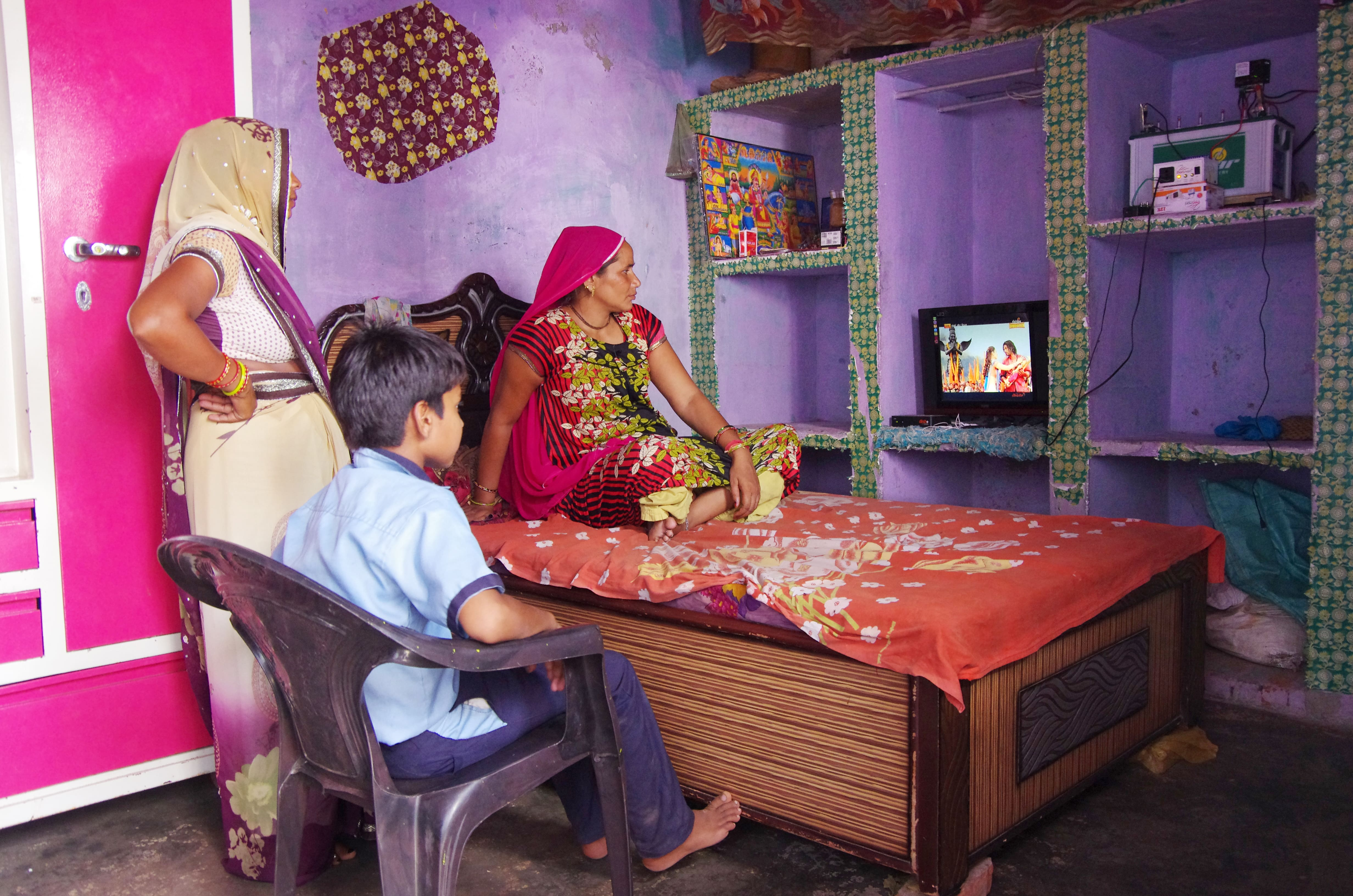 Rural household enjoying solar TV in the comfort of their homes