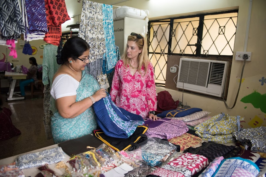 Jane examines products in a Kolkata, India shelter with a shelter staff member_preview