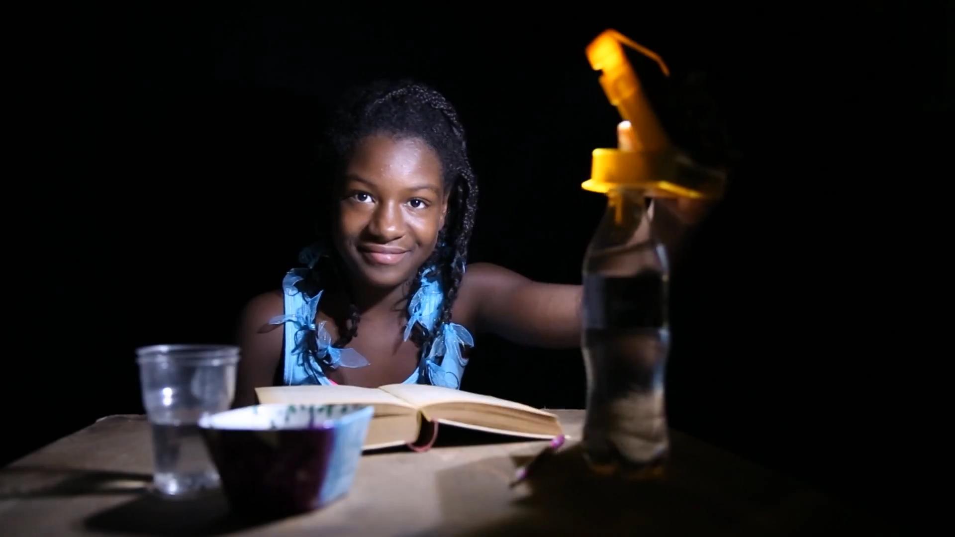 WakaWaka Light - girl, night reading, high res