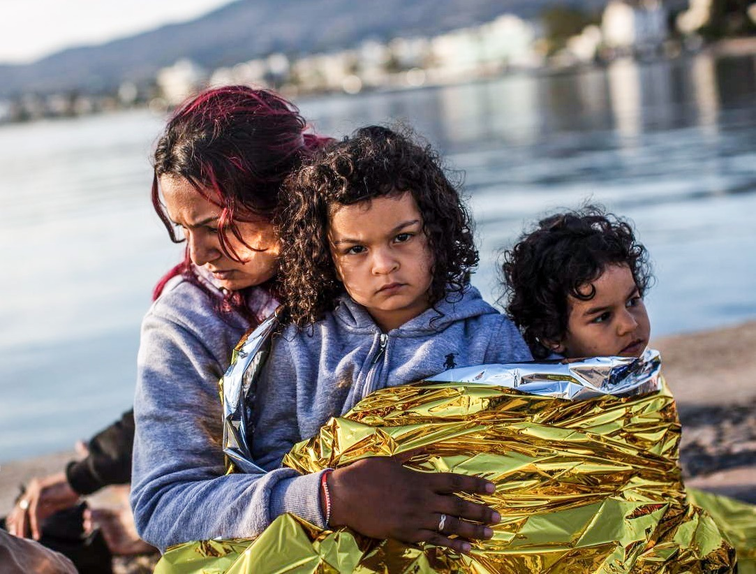 A Syrian family waits after being escorted into the harbor by the Greek Coast Guard, which found them drifing offshore on June 4, 2015, in Kos, Greece.