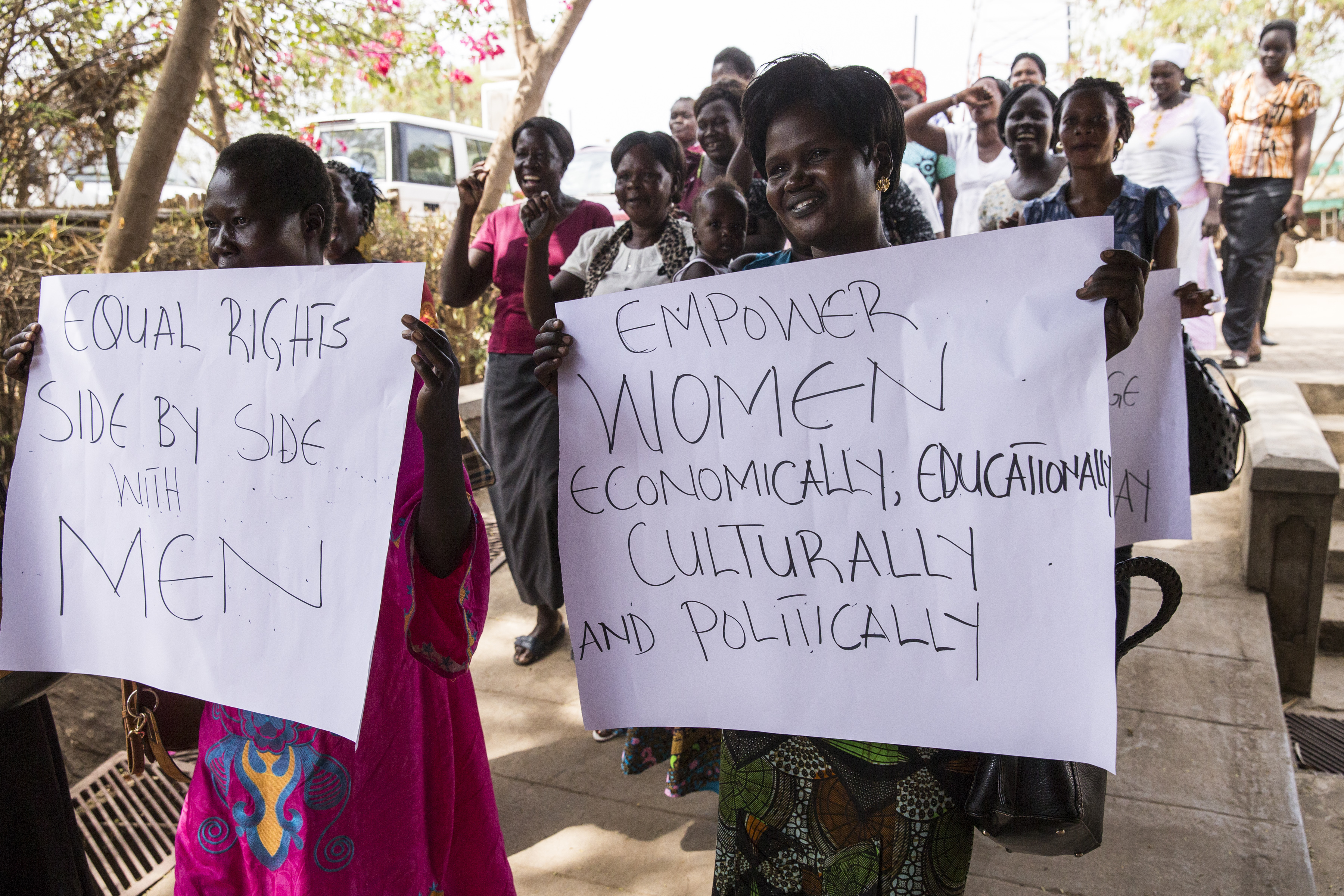 """International Women's Day celebration in South Sudan, held at Nyakuron Cultural Centre. The event, organized by the Ministry of Gender, Child, and Social Welfare, was held under the local theme """"South Sudanese Pledge for Ending Child Marriage"""" and the global theme """"Pledge for Parity"""", which calls for 50/50 gender parity by the year 2030. Participants arrive in procession at the event."""