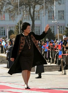 Roza Otunbayeva, Former President of Kyrgyzstan wearing a long velvet jacket from Dilbar Fashion House