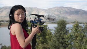 Nanfu Wang filming on location