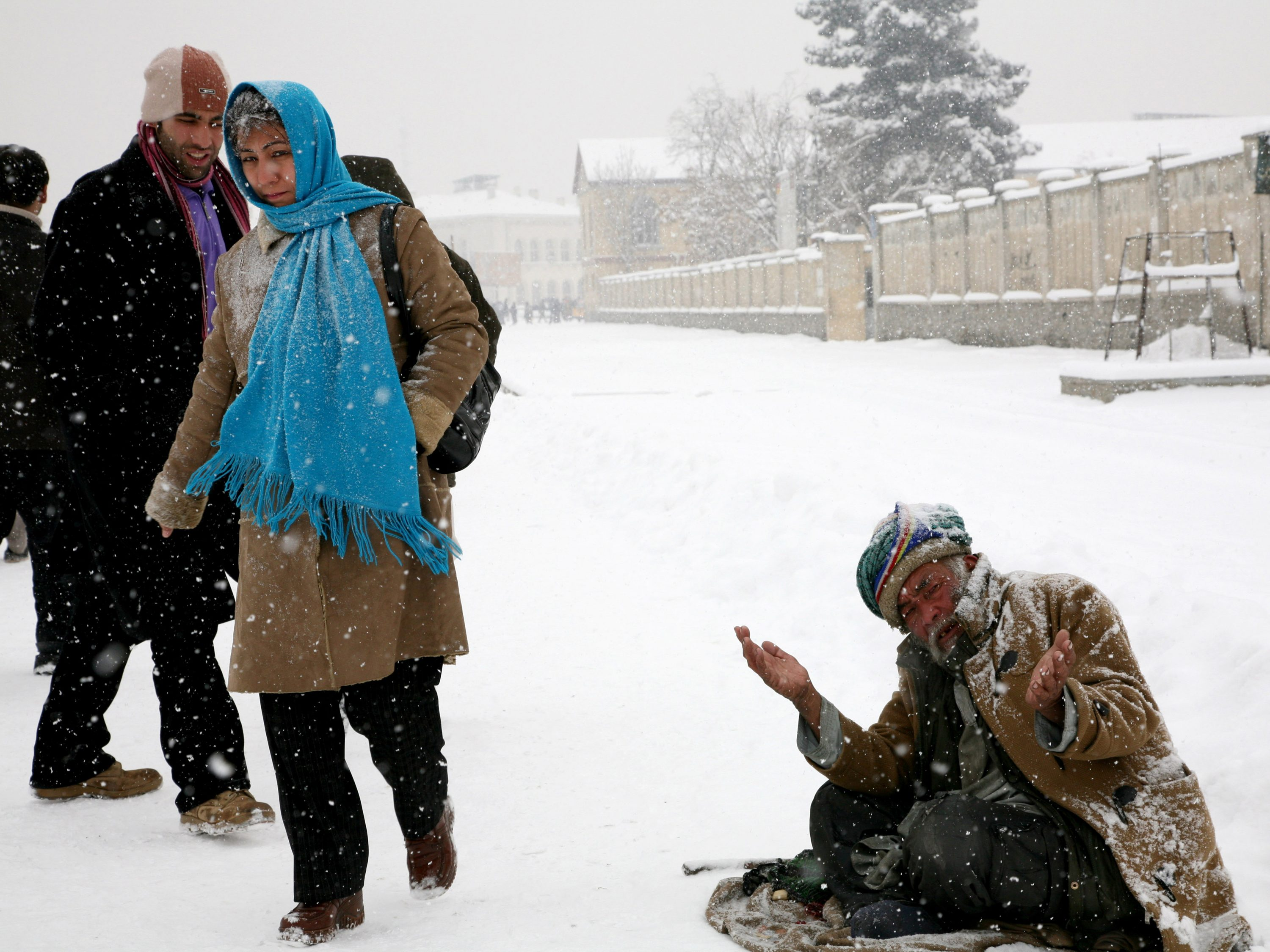 Poverty still drives people out of their homes, even on a snowy day, to earn a living.