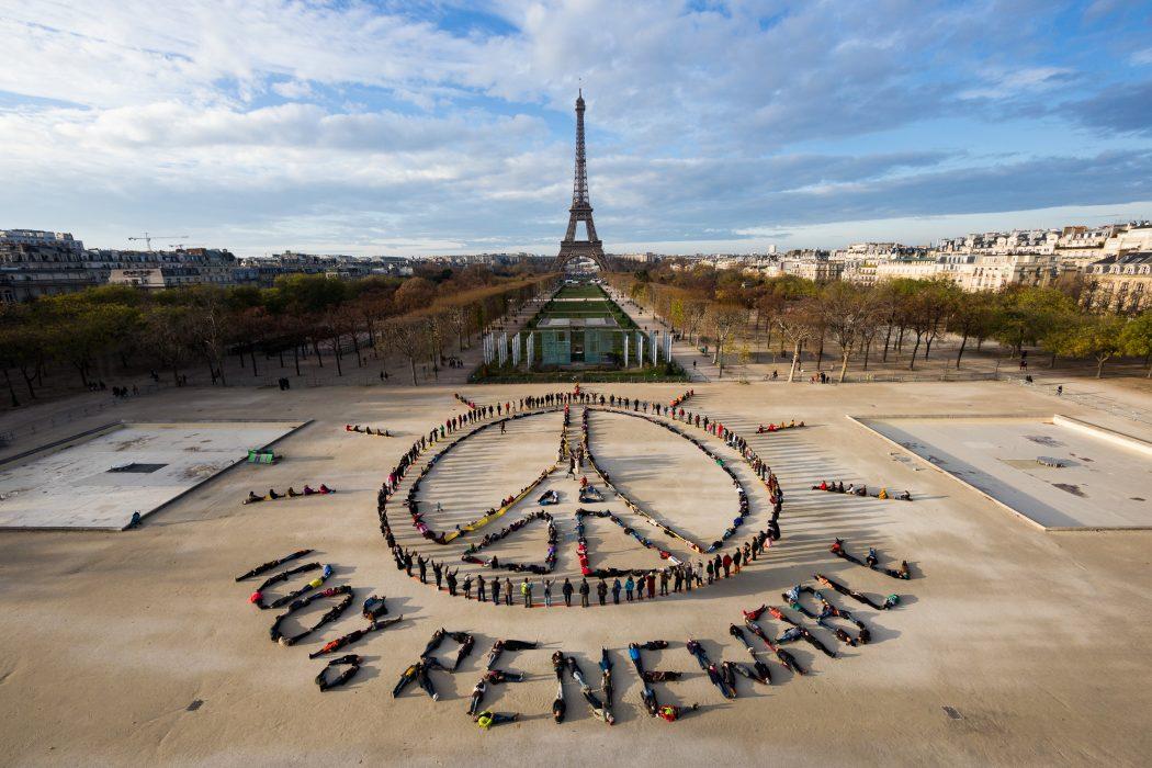 Eiffel Tower Peace Symbol – 100% Renewable 06.12.15 © Yann Arthus-Bertrand _ Spectral Q (1)