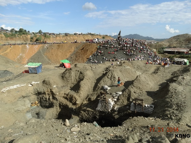 KDNG - Jade miners working at a mine site in Hpakant