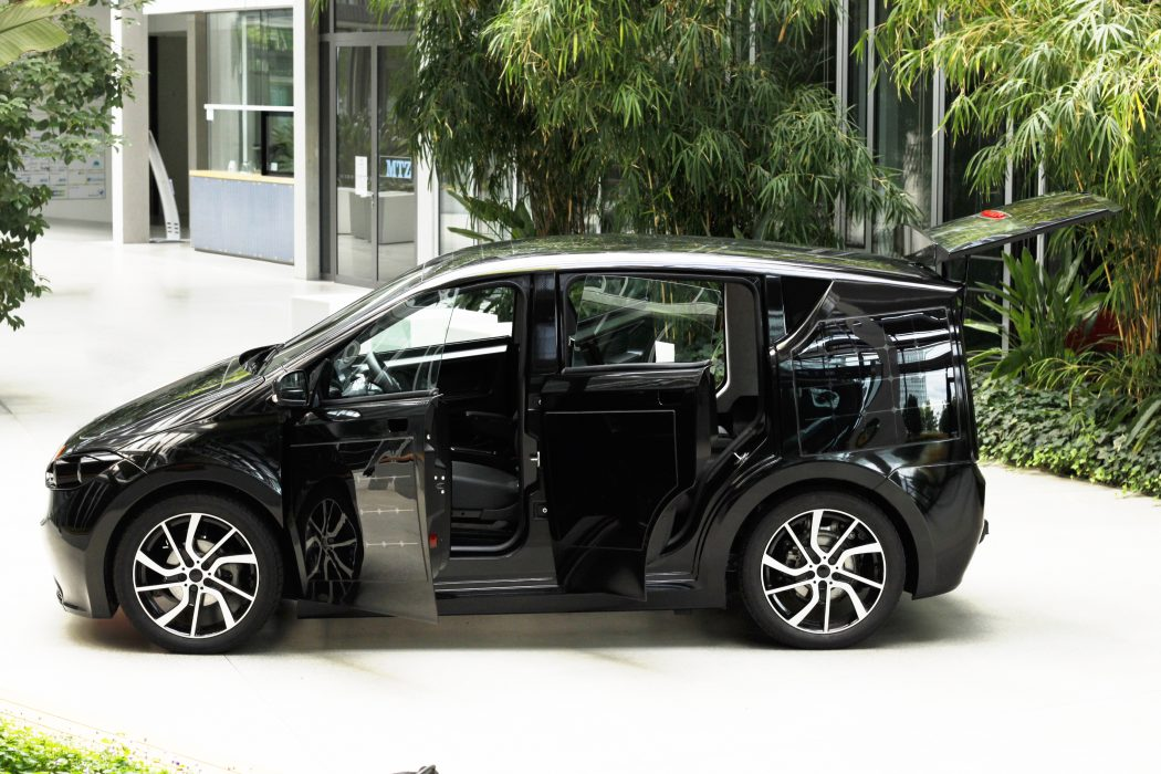 Sion_Exterior_black_sideview_doorsopen COVER