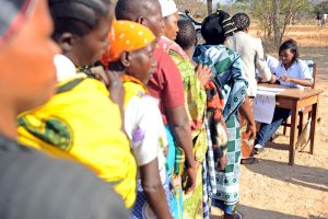 05 September 2012, Chamwino, Tanzania - Input trade fair hosted by the Chamwino District council and facilitated by FAO. For the first time 400 farmers from 5 villages were granted trade vouchers by FAO that enabled them to purchase the quality declared seeds and farm equipment from the agro dealers at the trade fair. A series of droughts in central Tanzania has challenged the food security of rural farmers and reduced the availability of quality seeds and crop varieties, increasing the level of poverty in the region. In response, The Food and Agriculture Organization (FAO) launched the Disaster Response and Preparedness to Drought project, funded by DFID, to provide the basic stock of quality declared seeds and support the farmers groups. By using seed-based response mechanisms and good agricultural practices, FAO and DFID are enhancing the capacity of farming communities to prepare for and respond to climate variability. FAO Project: OSRO/URT/001/UK - Emergency supply of maize seeds to drought-affected farmers in Tanzania /(New phase) Disaster Response and Preparedness to Drought. - 2012. Objectives: The general objective of this project is to provide emergency seed support to farming families in 34 districts affected by drought in order to avert food insecurity and possible starvation. The specific objective of this project is to distribute a total of 1 592 tonnes of seed to 159 200 food insecure households to cover an estimated 64 427 hectares of land with an expected yield of 96 640 tonnes of maize.
