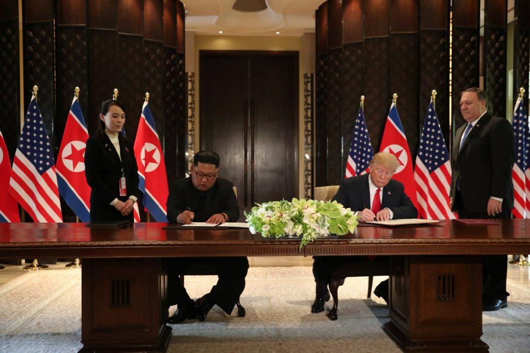 Trump and Kim Jong Un signing agreement 12 June Reuters