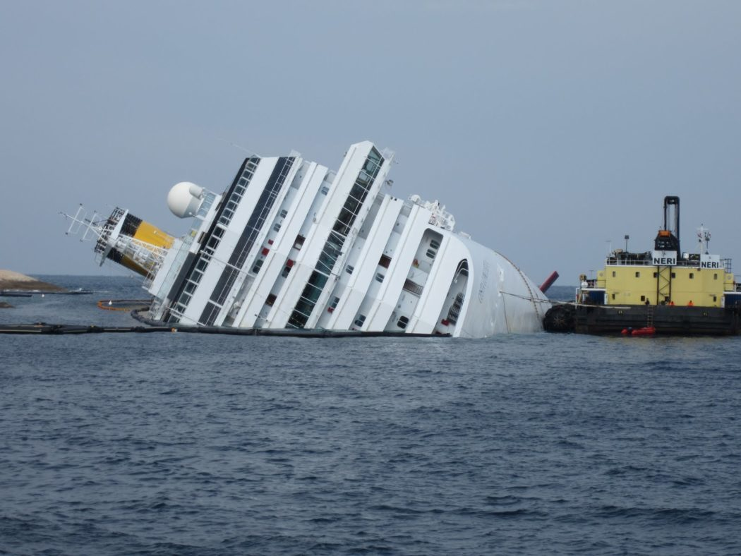 Grounded_and_partially_capsized_Cruise_ship_Costa_Concordia_and_the_Ocean_Crane_Barge_Meloria_-_12_Feb._2012